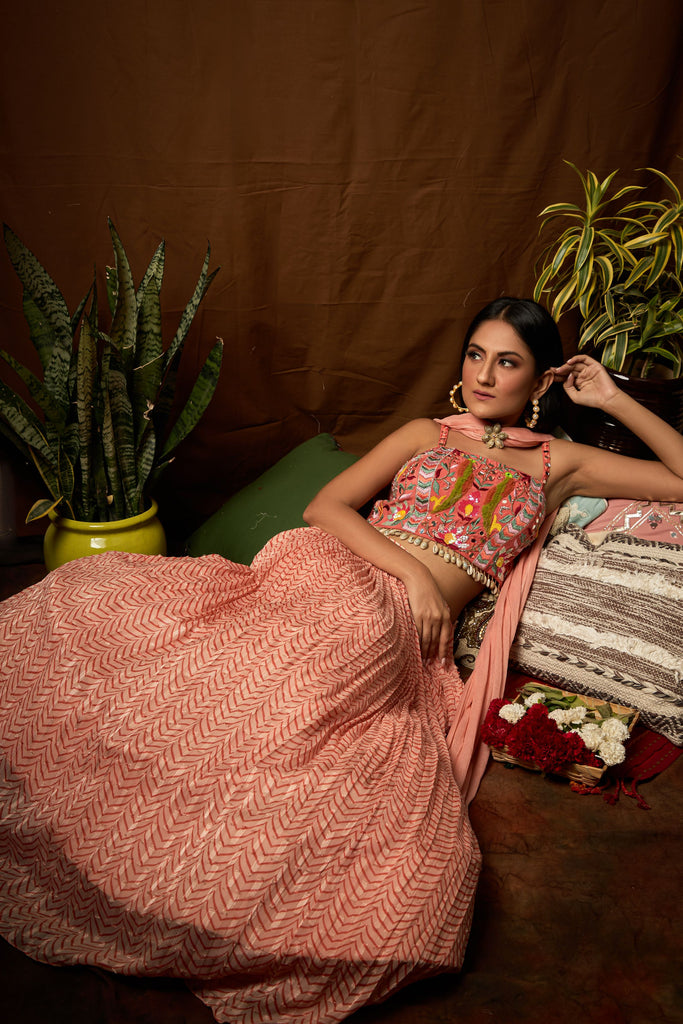 Printed skirt with embroidered blouse and shells detailing and dupatta