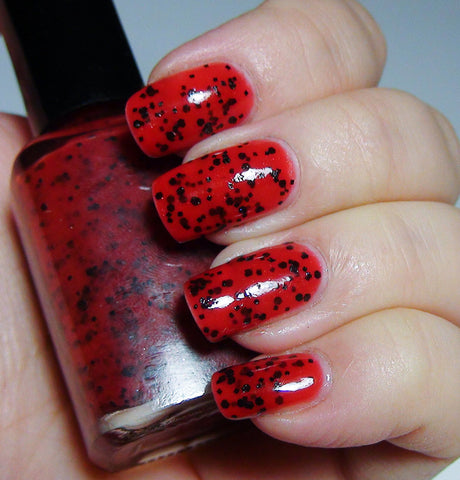 Enchante - red & black jelly - GLOWS blue