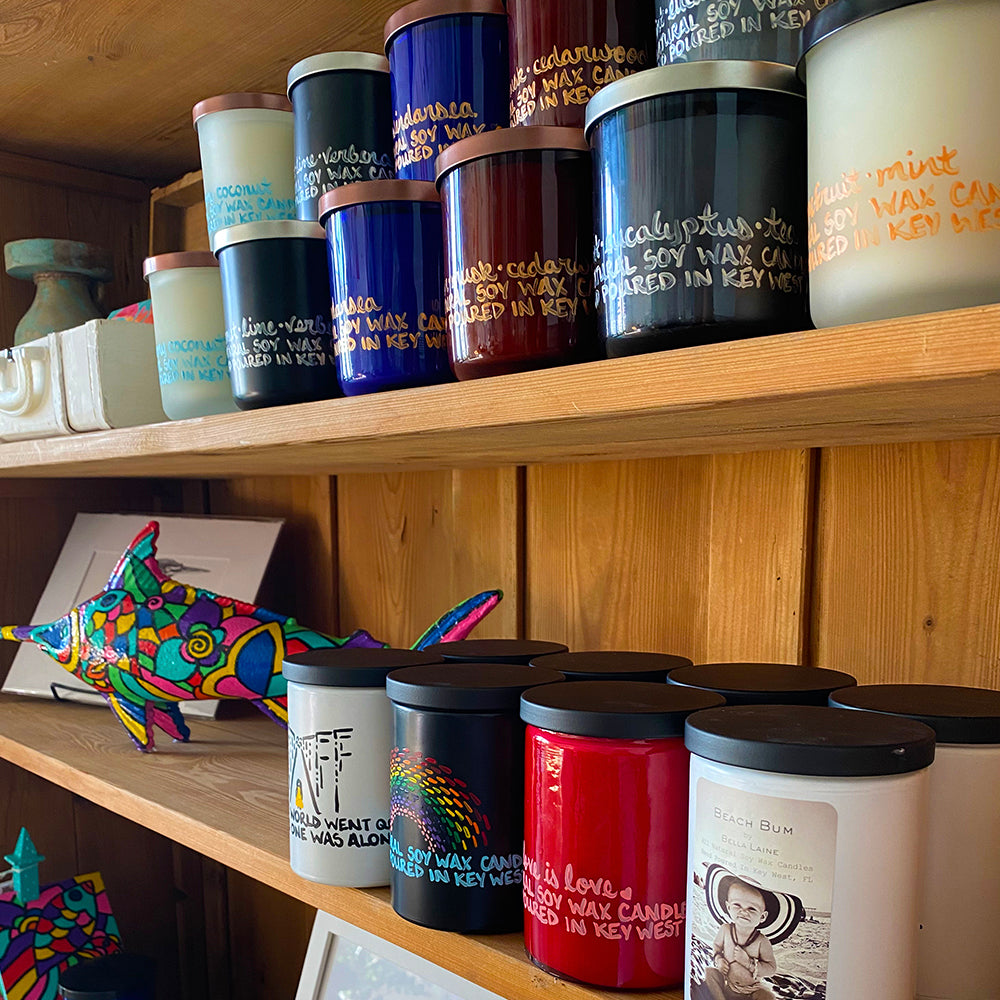 Bella Laine candles sitting on a shelf at Sacred Space Key West, An Artist Collective
