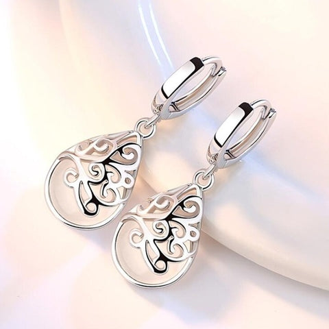 Round Hollow Retro Earrings