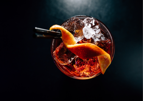 Negroni cocktail on a bar with a dark background