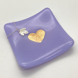 Lavender glass trinket dish with a necklace