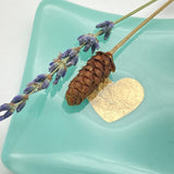 Teal glass trinket dish with dried flowers