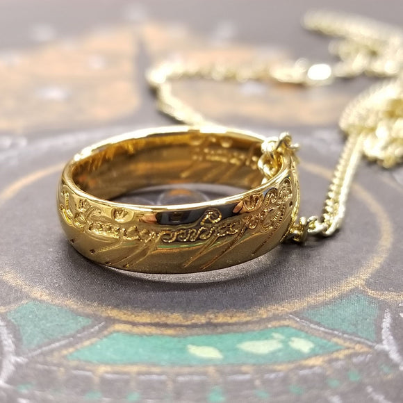 The One Ring, also called The Ruling Ring and Isildur's Bane, is crafted in solid bronze by the Badali Jewelry artists and then barrel plated with pure 24k gold. Each One Ring pendant has the appearance of solid gold, hence the name, Gollum Gold. Our Gollum Gold One Ring appeared in an episode of The Big Bang Theory.