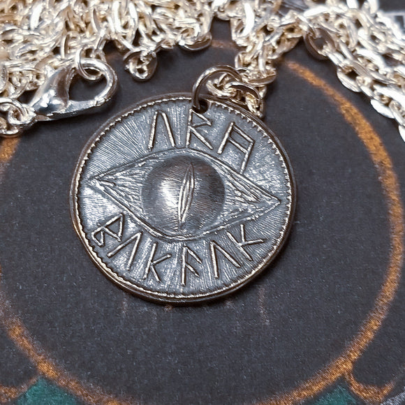 This Sauron Eye Silver Pendant is crafted in celebration of The Lord of the Rings by J. R. R. Tolkien. This coin is struck from solid 35% silver. It is presented on a 30