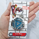 "Iron Man Glow-In-The-Dark Pewter Arc Reactor Keychain.  In Celebration of Tony Stark's Iron Man as seen in the Marvel Studios Avengers films, this oversize pewter Arc Reactor glow-in-the-dark metal keychain features the Arc Reactor powering Tony's chest and power suit in Iron Man 3.  2 inches across & nearly 1/2 inch thick!  Features ""Iron Man"" logo on the back Includes stainless steel keyring and clip Blue Glow-in-the-Dark effect!  Carry your own Proof that Tony Stark Has a Heart"