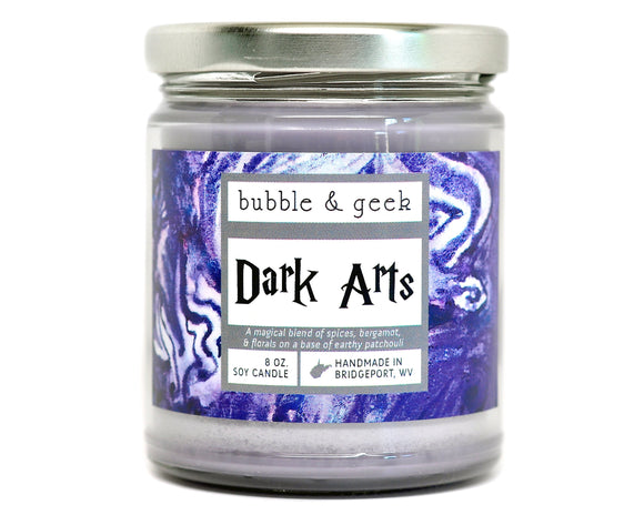 The Dark Arts Harry Potter Candle Jar This scent is a magical blend of spices (mainly cinnamon), bergamot, and florals with a trace of earthy patchouli. The dark arts are known to be dangerous, often deadly. Perhaps you should take a class on how to defend against them......   Bubble and Geek's soy candles are made by hand in small batches, and we add the maximum amount of fragrance oil the wax will allow.