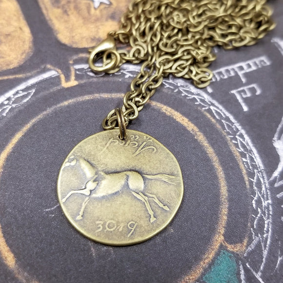 This Rohan Brass Brumby coin pendant from the The Lord of the Rings by J. R. R. Tolkien is struck from solid brass. It is presented on a 30