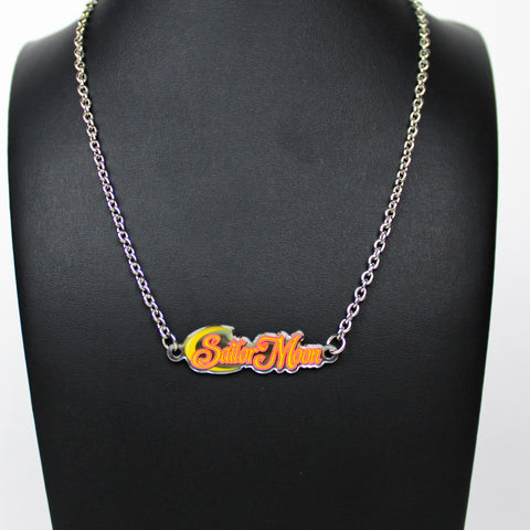 """Fighting evil by moonlight, winning love by daylight, never running from a real fight, she is the one named Sailor Moon!""  Celebrate your love for all things Sailor Moon with power and beauty with this Sailor Moon anime logo necklace!  Official Sailor Moon anime jewelry Arrives on colorful Sailor Moon card packaging."