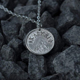 "This Sauron Eye Silver Pendant is crafted in celebration of The Lord of the Rings by J. R. R. Tolkien. This coin is struck from solid 35% silver. It is presented on a 30"" plated chain, certified nickel-free. Coin artwork by Greg Franck-Weiby.  This coin is treated to look as if they have been handled and circulated. This process is done by hand, and it is both an art and a science. Coloring and patinas will vary. No two coins will ever look exactly the same."