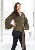 The Galactic Knight Wrap Top by Elhoffer Design - A Star Wars inspired design based on the Jedi Knights in a galaxy far, far away.   Princess Seam Wrap Top in the Olive color Wraps at Natural Waist Trumpet Sleeve Made from Heavyweight Stretch Ponte de Roma (Rayon/Nylon/Spandex) Designed and manufactured in Los Angeles, California to ensure each garment is crafted with the utmost care and caliber.