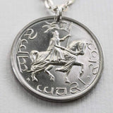 "This GONDOR Crown Pendant Necklace from the Lord of the Rings by J. R. R. Tolkien is in honor of Aragorn. The coin is struck from solid nickel silver, measures 3.2 cm in diameter, and weighs about 13.2 grams. Mounted on a 30"" plated chain that is certified nickel-free. Coin artwork by Greg Franck-Weiby."