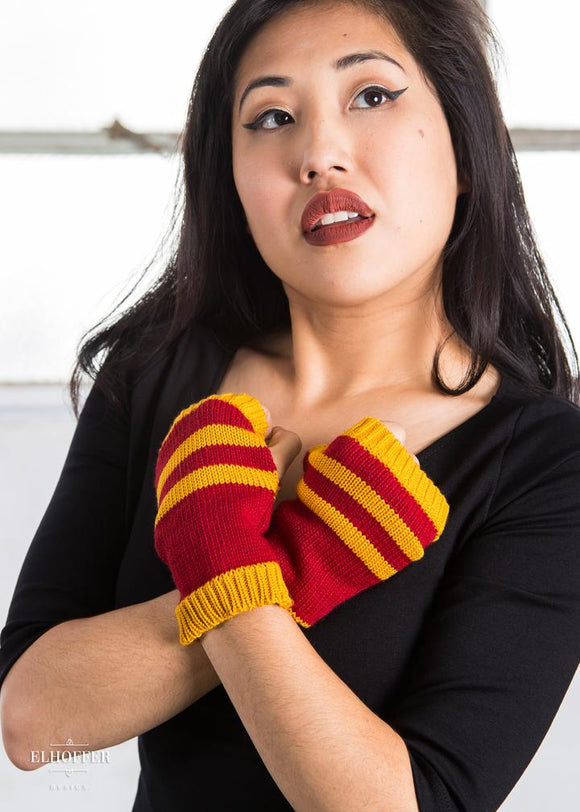 Bravery Striped Fingerless Gloves by Elhoffer Design - Inspired by House Gryffindor from Harry Potter.  Custom Knit Gloves  Acrylic Yarn - Our custom dyed Emerald Green paired with grey. Designed and manufactured in Los Angeles, California to ensure each garment is crafted with the utmost care and caliber.  Care: We have tested this piece in the wash on cold water, and it comes out fine. We DO NOT recommend putting it in the dryer - dry flat!