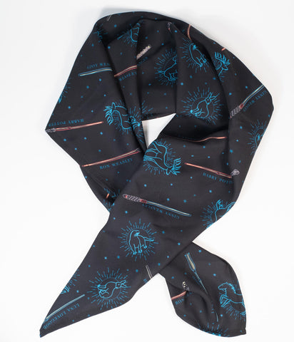 Harry Potter Patronus Print Fashion Scarf by Unique Vintage  Show off your magical guardian with this adorable hair scarf from Unique Vintage in a charming collaboration with the Harry Potter! Crafted in a silky chiffon, this vintage pin-up accessory features the Patronus symbols printed throughout a black backdrop. A fabulous accessory for tying up and around your divine 'do - any excuse for a little sky-high hair help!