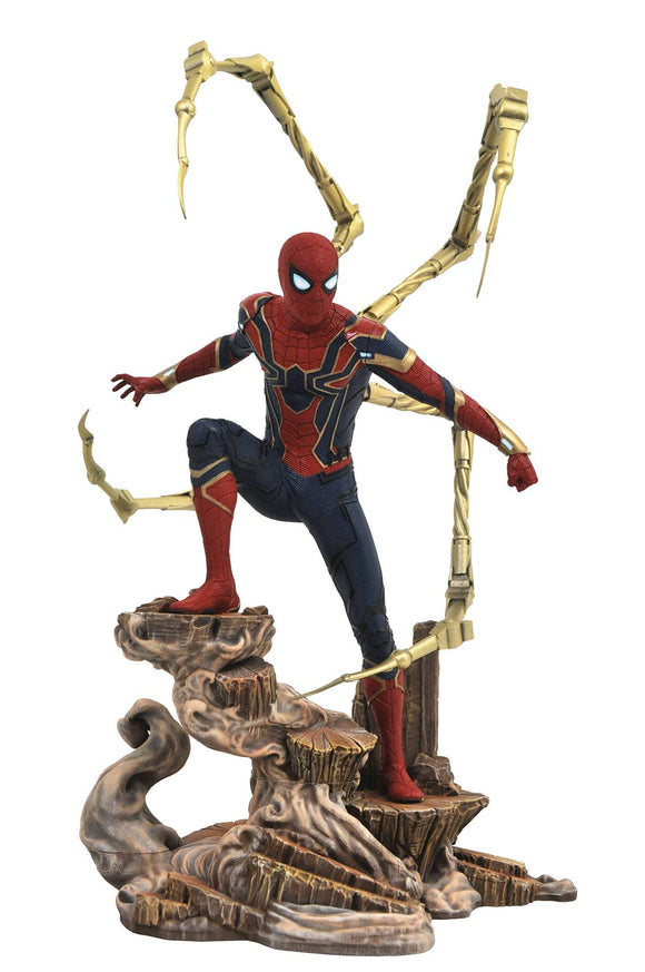 Stock photo of The Iron Spider Spider-Man Gallery Statue by Diamond Select Toys. Spider-Man is posed on a rock formation in his Iron-Spider suit as seen in Avengers: Infinity War