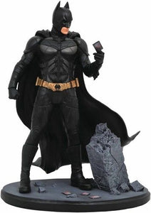 "Batman The Dark Knight Movie Gallery Statue  ""It's not who I am underneath, but what I do that defines me."" - Bruce Wayne / Batman  He's the hero Gotham deserves, and now he's the latest PVC Diorama in the DC Movie Gallery line! Based on Christopher Nolan's movie The Dark Knight, this sculpture of Batman shows him examining a playing card amid the rubble of one of the Joker's escapades. Measuring approximately 9 inches tall, this movie-accurate diorama comes packaged in a full-color window box."