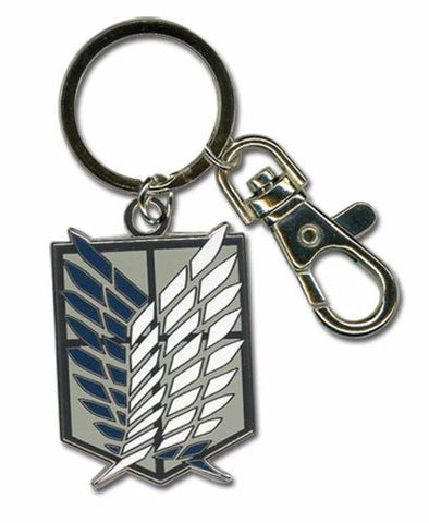 An enameled metal keychain with clip and ring, depicting the Scout Regiment (Scout Legion) emblem from Attack on Titan.  The metal emblem is approximately 1 inch wide by 1.5 inches tall.