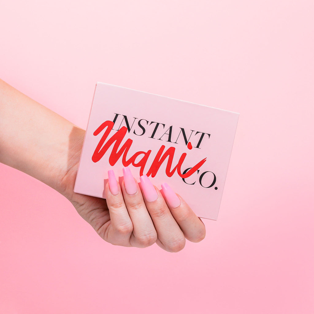 Hand wearing pink ombre Instant Mani press-on nails Australia