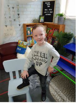 William in his never give up jumper