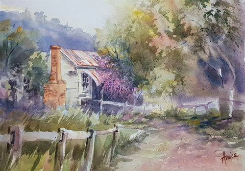 watercolour painting of an old derelict house in the countryside