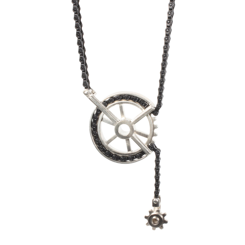 Adjustable necklace with a spinning sprocket pendant