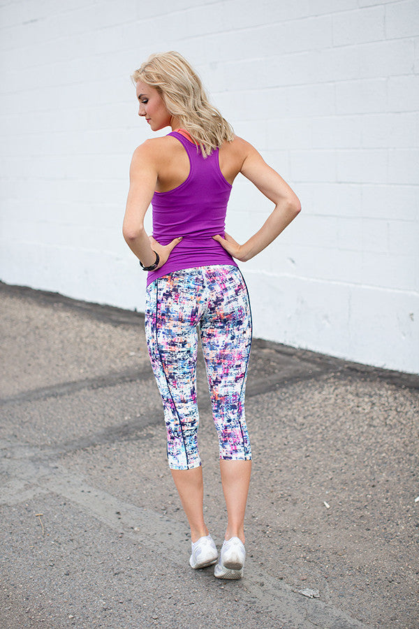 WILD MULTI COLORED PRINT CROPPED ATHLETIC LEGGINGS