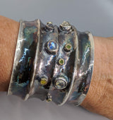 Wide Sterling Silver Cuff Bracelet with Rainbow Moonstones, Green and Yellow Diamonds in 14kt Gold Bezels