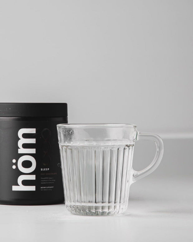 Animated GIF showing hom sleep supplement being added to water and stirred.