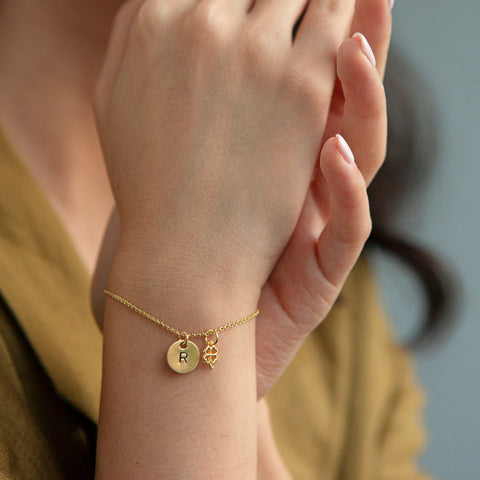 Bracelet with a Letter in gold