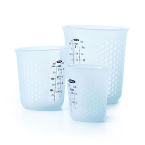 Squeeze and pour measure cup