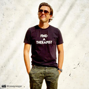 Handsome man wearing black custom text tee reading Find A Therapist by BBJ / Glitter Garage