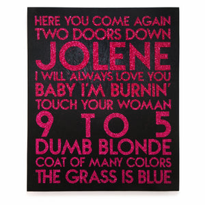 Dolly Parton songs - hot pink glitter text on black wood art plaque - YourTen typography wall art by BBJ / Glitter Garage