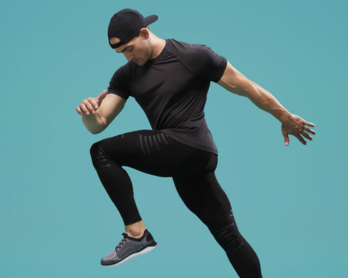 a man wearing Stoko knee support and compression pants