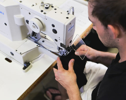 A man sewing Stoko knee support tights made from breathable stretchable soft material