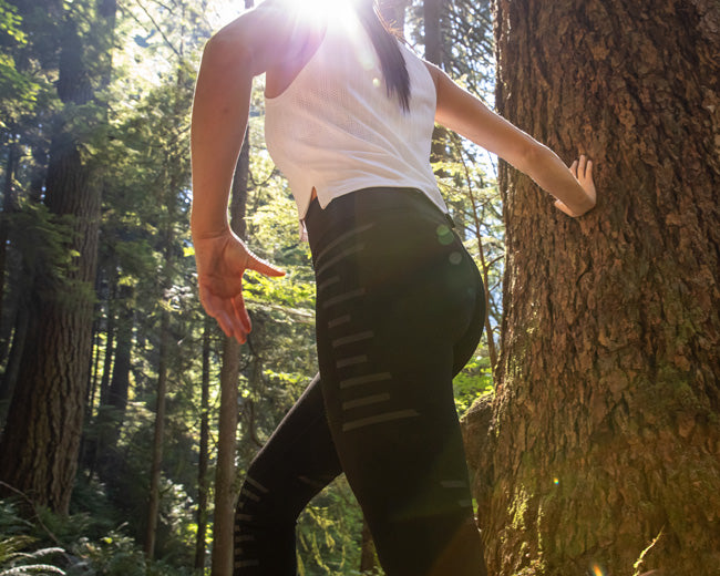 A woman hiking in a knee support tights that are a great alternative to knee braces