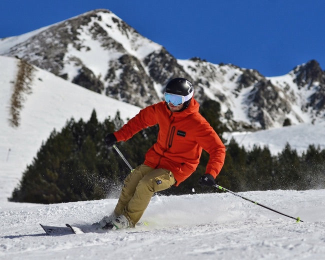 A man skiing in Stoko K1 knee braces with compression
