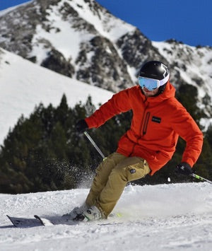 A skiing man wearing a knee support