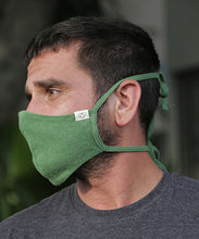 Load image into Gallery viewer, We are now offering our four tie mask with stretch. This style has four straps that tie easily behind the head and neck for a snug fit.  Mask is two layers with a pocket. Shown here in Treetop Green.