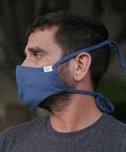 Load image into Gallery viewer, This style combines a tailored mask with earloops for a snug fit with ease and comfort. Mask is two layers with a pocket. Shown here in Ocean Blue.