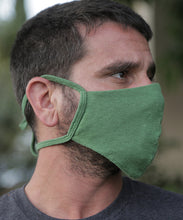 Load image into Gallery viewer, This style combines a tailored mask with earloops for a snug fit with ease and comfort. Mask is two layers with a pocket. Shown here in Treetop Green.