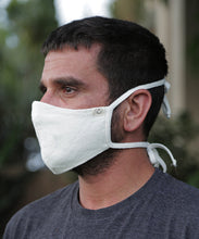 Load image into Gallery viewer, This style combines a tailored mask with earloops for a snug fit with ease and comfort. Mask is two layers with a pocket. Shown here in Natural.
