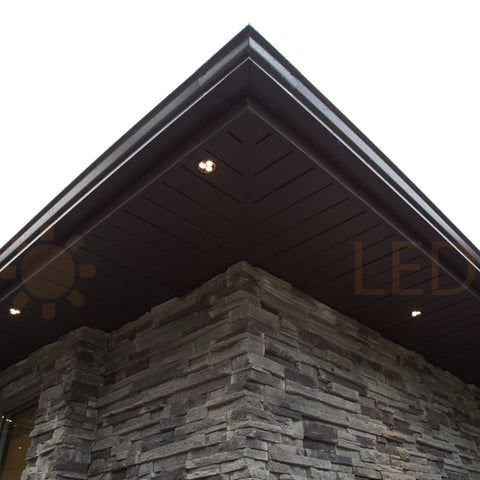 Dark bronze recessed lights match brown soffits perfectly