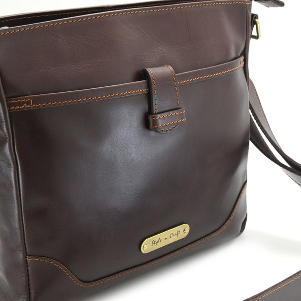 Style n Craft 392001 Cross-body Messenger Bag in Full Grain Dark Brown Leather - Front Profile View showing the Front Pocket and Logo