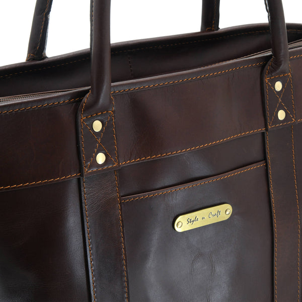 Style n Craft 392003 Men's Tote Bag in Full Grain Dark Brown Leather - Front Angled Closeup View Showing the front Outside Pocket