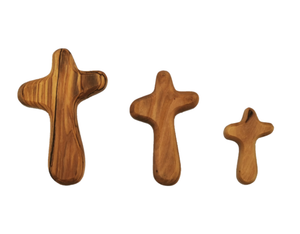 Hand carved olive wood holding cross, small, medium and large, made in Bethlehem. Unique grain, fits in palm of hand