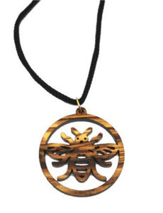 Manchester bee olive wood necklace, made in Bethlehem. Hung on black cord