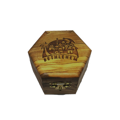 Polished olive wood trinket box hand made in Bethlem. Golden clasp on from and image of Bethlehem and wording on top