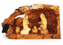 Load image into Gallery viewer, hand crafted nativity grotto, made in Bethlehem. faceless figures of Mary, Joseph, baby Jesus and lambs