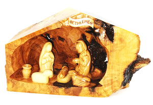 hand crafted nativity grotto, made in Bethlehem. faceless figures of Mary, Joseph, baby Jesus and lambs
