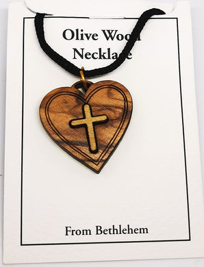 Handmade in Bethlehem, olive wood cross on heart  pendant with black cord in packaging